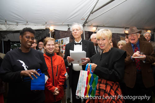On left, Rivertown Board member, Bea Pohl of Nyack names Hitchcock trivia contest winners with fellow board member Roger Seiler of South Nyack.